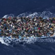 Refugees crowd on board a boat some 25 kilometers from the Libyan coast, prior to being rescued by an Italian naval frigate working as part of Operation Mare Nostrum (OMN). (Massimo Sestini, General News, 2nd prize singles)